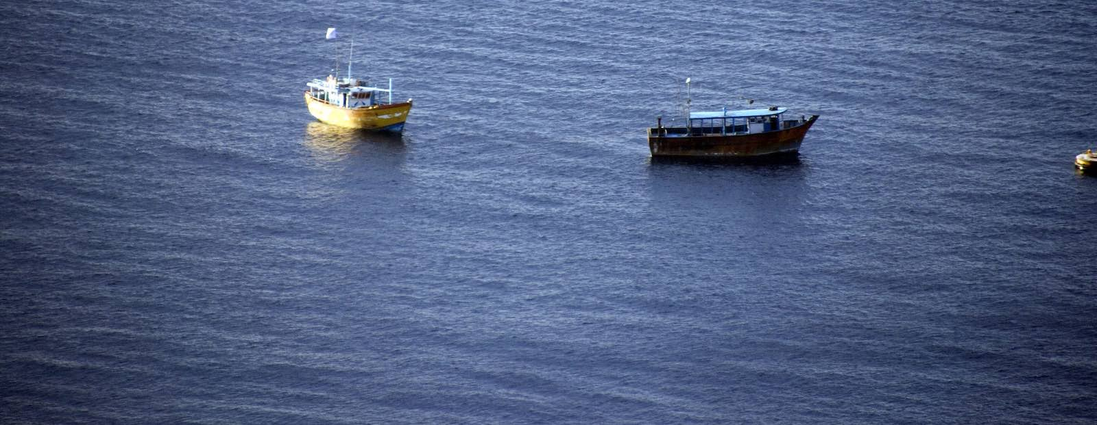 Asylum seeker boats moored off Christmas Island in 2012 (Photo: frogtrail images/Flickr)