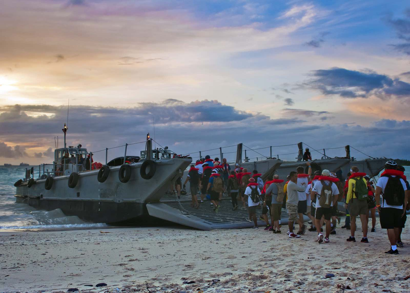 US personnel boarding a landing craft for a tip-to-tip bike ride around Diego Garcia (US Pacific Fleet/Flickr)