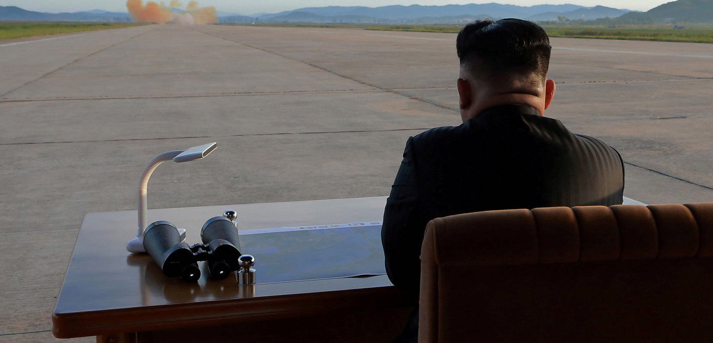 North Korean leader Kim Jong Un watches the launch of a Hwasong-12 missile in this undated photo released by North Korea's Korean Central News Agency, September 2017