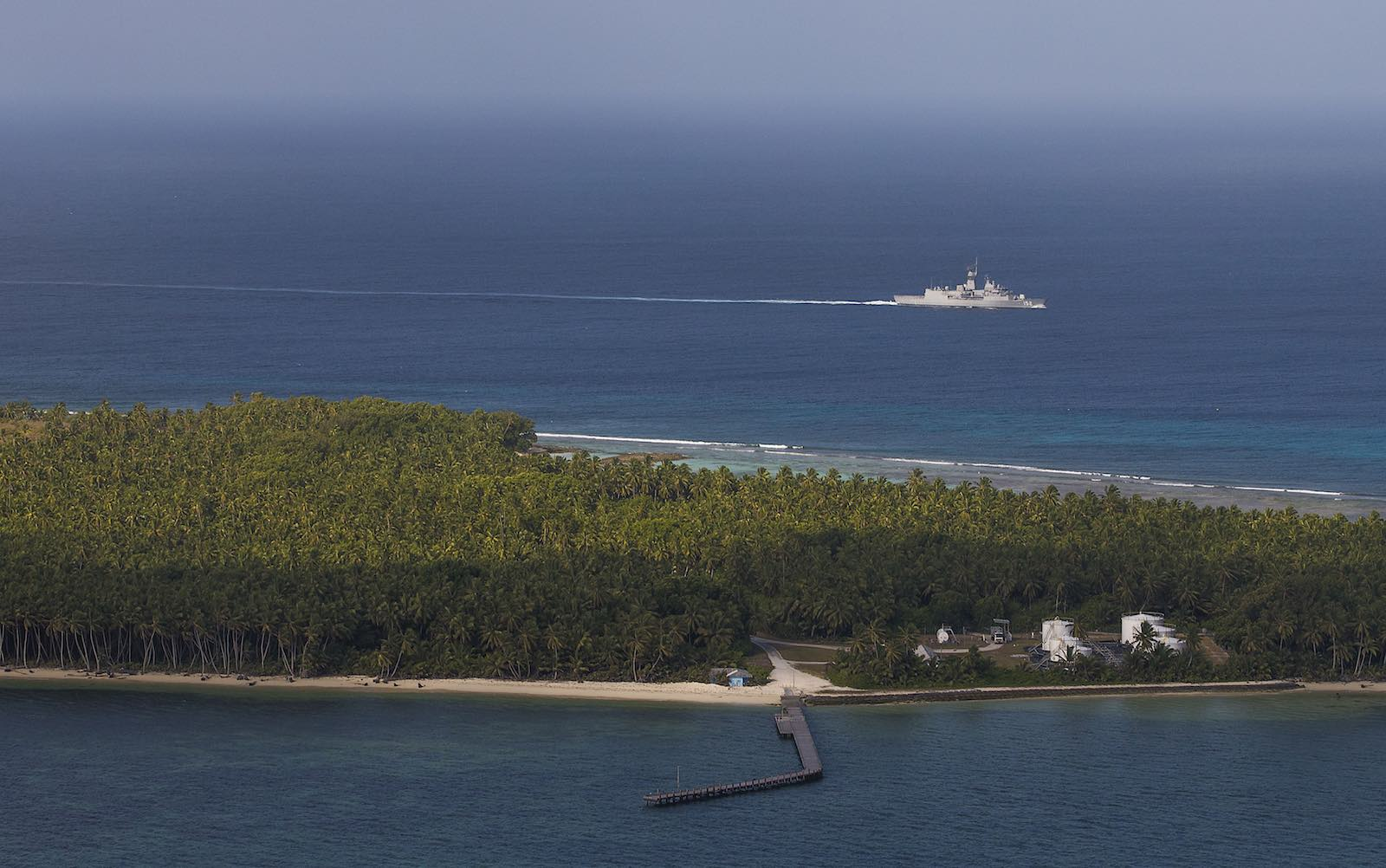 HMAS Warramunga sails past the Cocos (Keeling) Islands in the Indian Ocean (Defence Department)