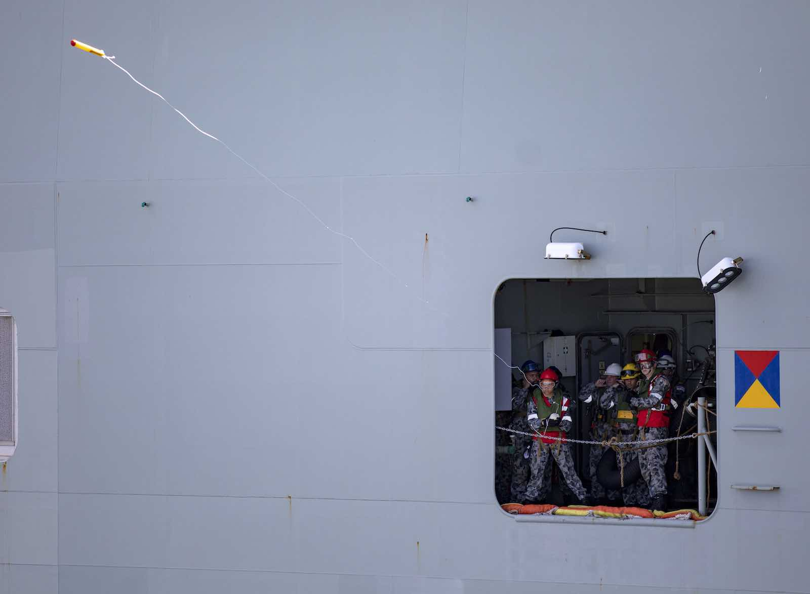 HMAS Canberra fire the lines for replenishment from HMAS Success as part of Indo-Pacific Endeavour 2019 (Department of Defence)