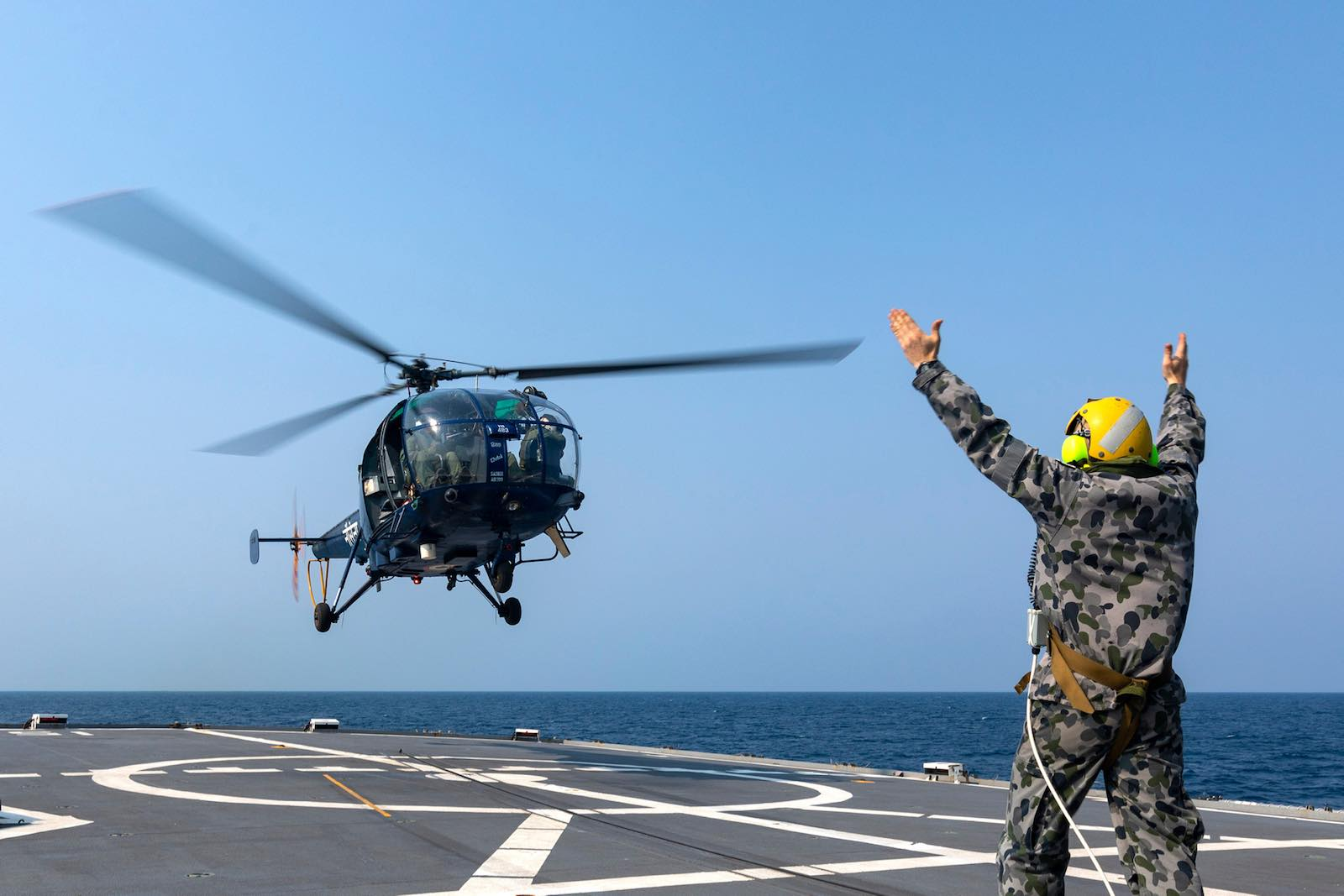 An Indian Navy Chetak helicopter lifts off from HMAS Parramatta during AUSINDEX 2019, in the Bay of Bengal (Australian Defence Force)
