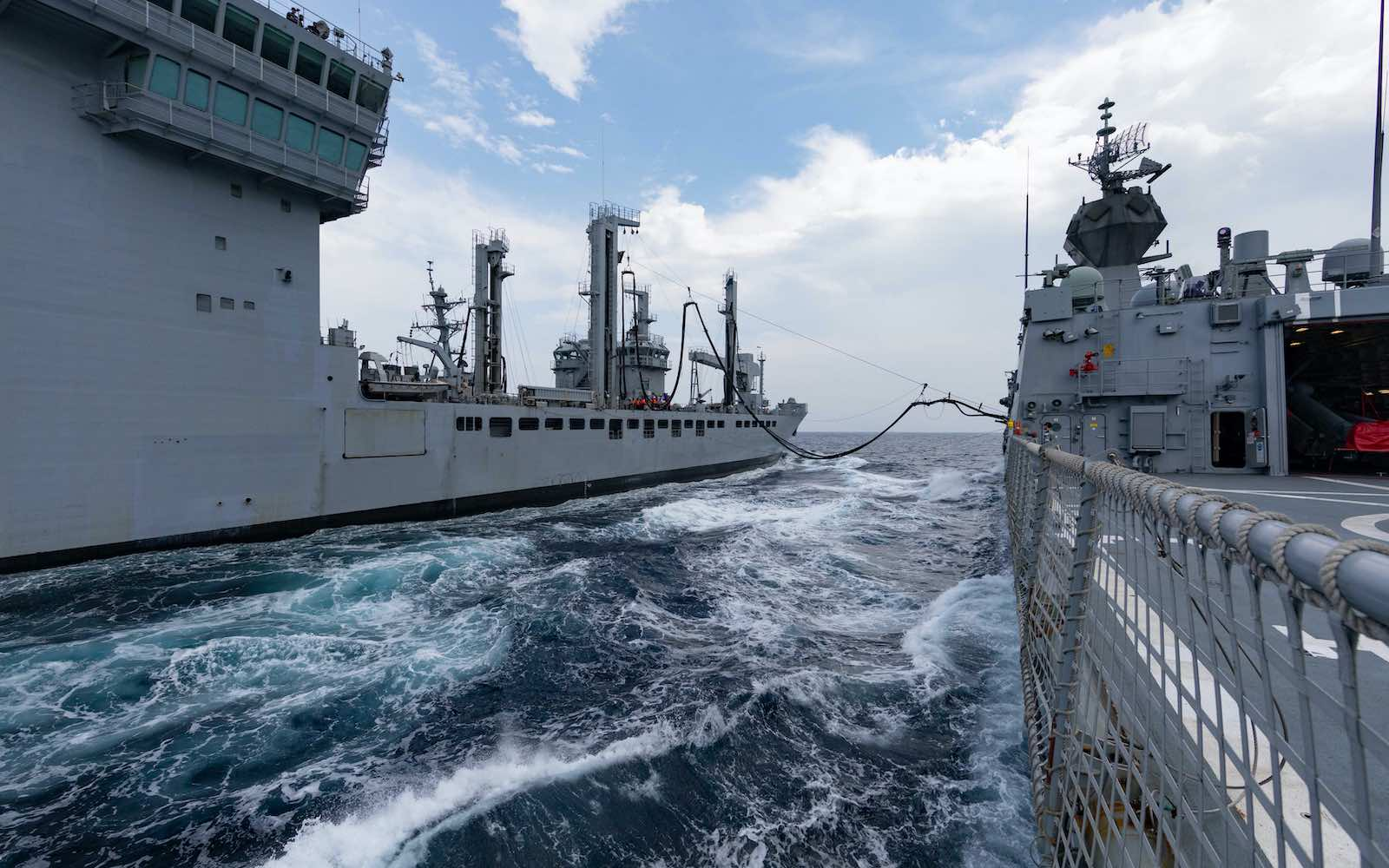 HMAS Ballarat (right) and Indian Naval Ship Shakti conduct a replenishment at sea during Exercise Malabar, November 2020 (Defence Department)