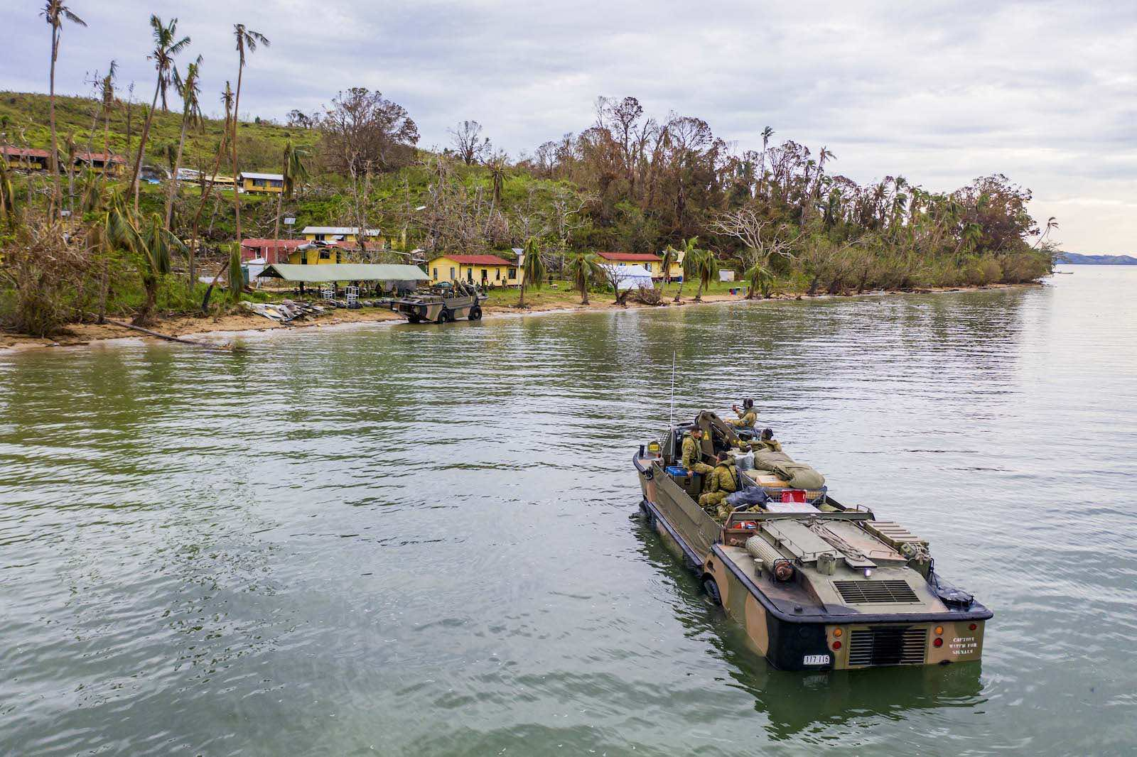 Australian soldiers land on the island of Galoa, near Vanua Levu, in Fiji to drop off supplies required to repair buildings affected by Cyclone Yasa in December 2020 (Department of Defence)