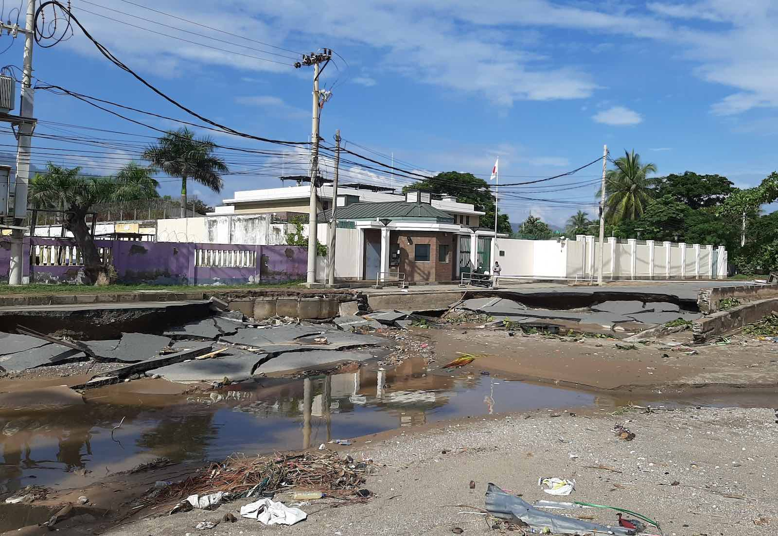 Collapsed road in front of the Embassy of Japan in Dili after recent floods (Author provided)