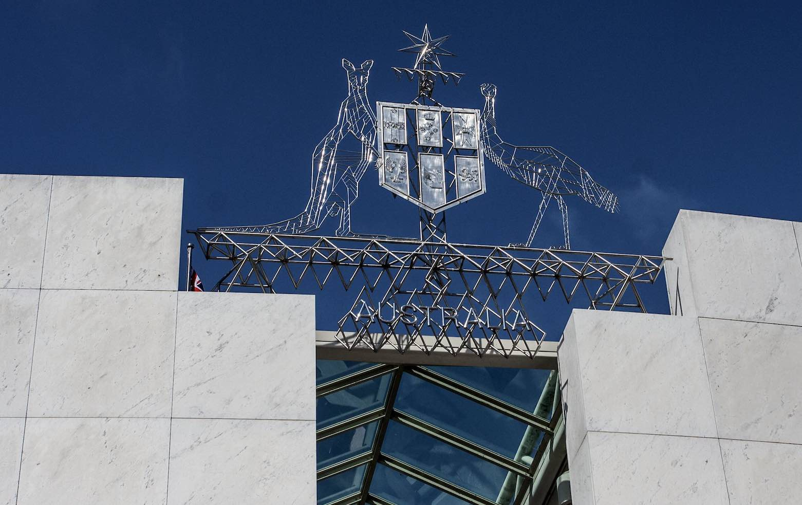 The Australian coat of arms over parliament house, Canberra (John/Flickr)