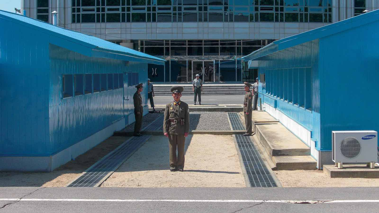 North Korean soldiers stand guard in the DMZ. (Photo: Brodie Karel/Flickr)