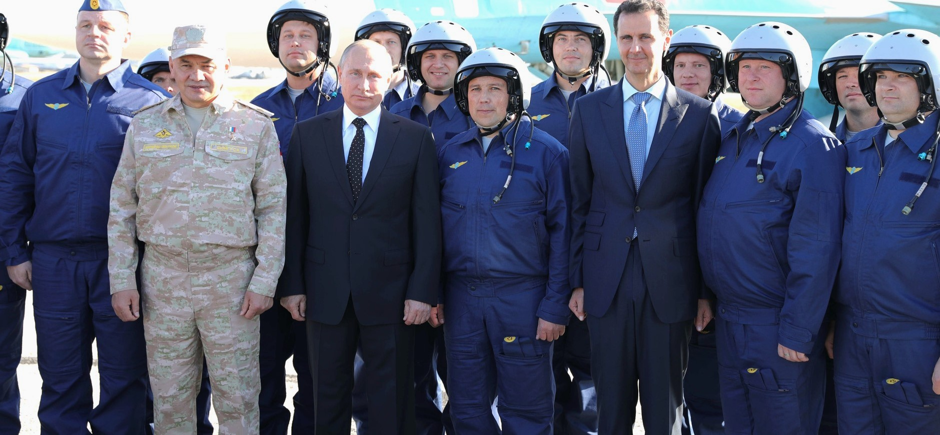 Russia's Vladimir Putin and Syria's Bashar al-Assad with Russian pilots at Khmeimim Air Base in Syria, December 2017 (Photo: kremlin.ru)