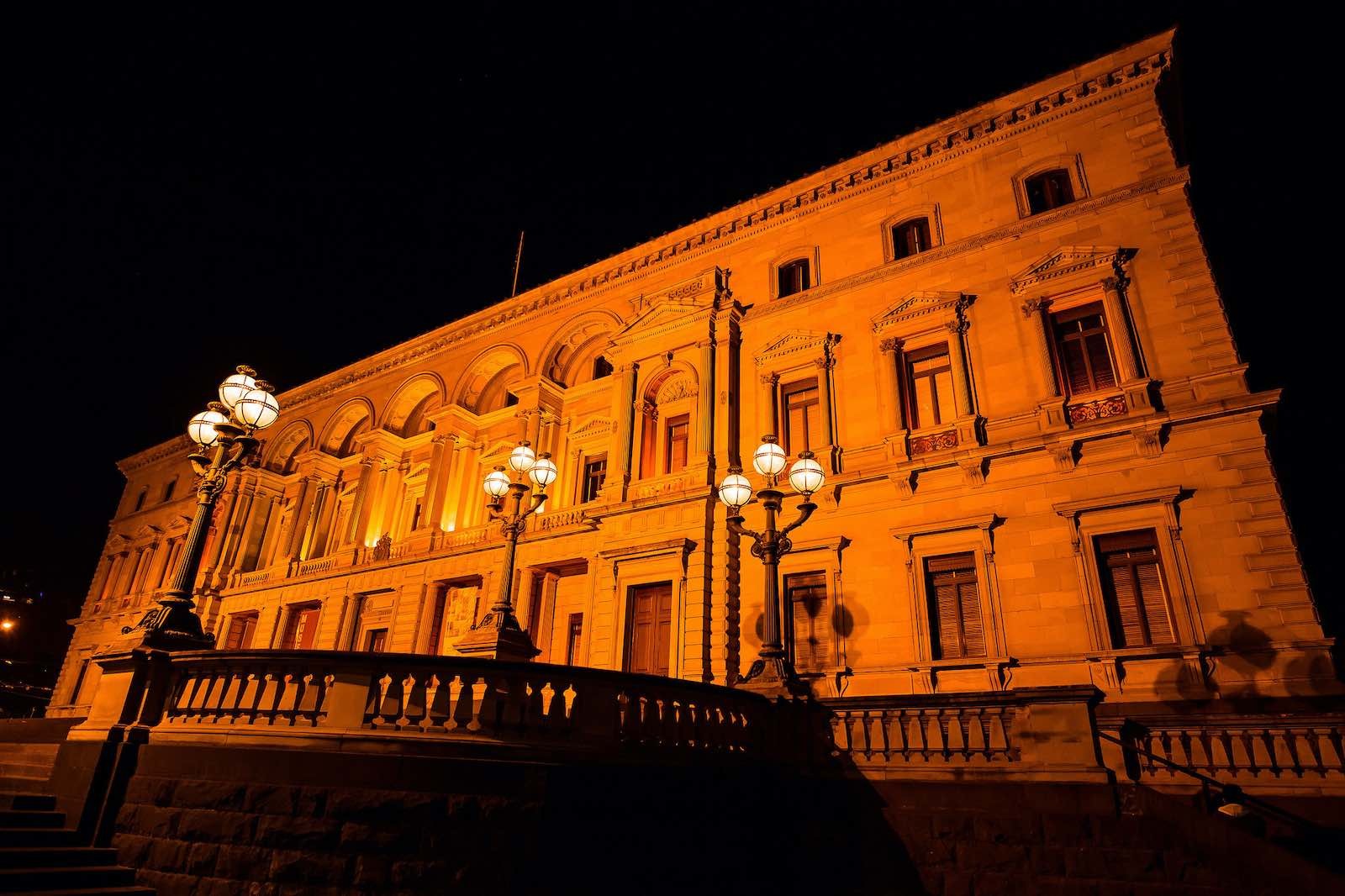 Treasury Building in Melbourne lit orange in commemoration of the 16 Days of Activism and the International Day to End Violence against Women in 2016 (UN Women/Flickr)