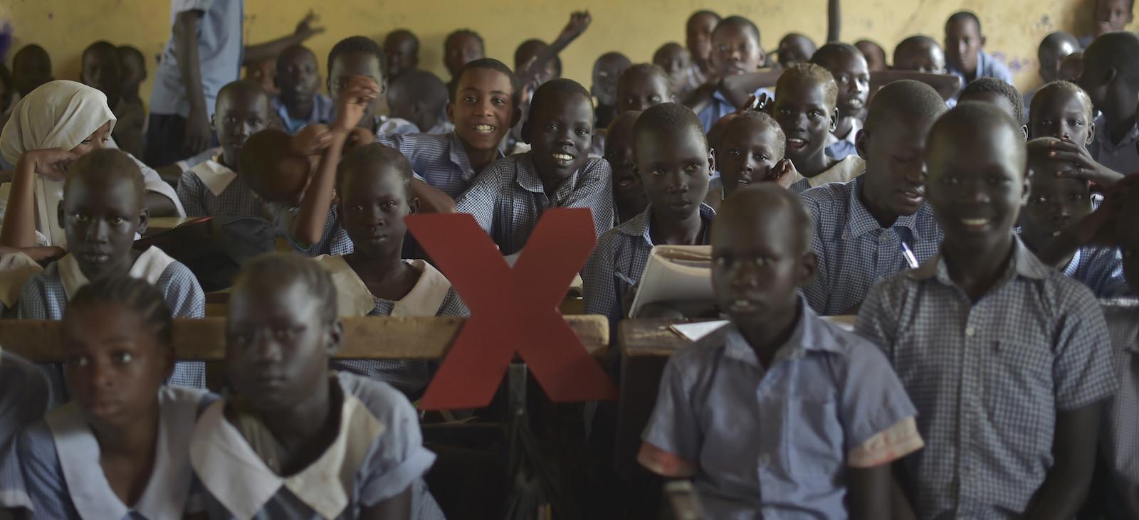 Refugees from Kakuma pose with the TedX logo (Photo: TEDxKakumacamp/Flickr)