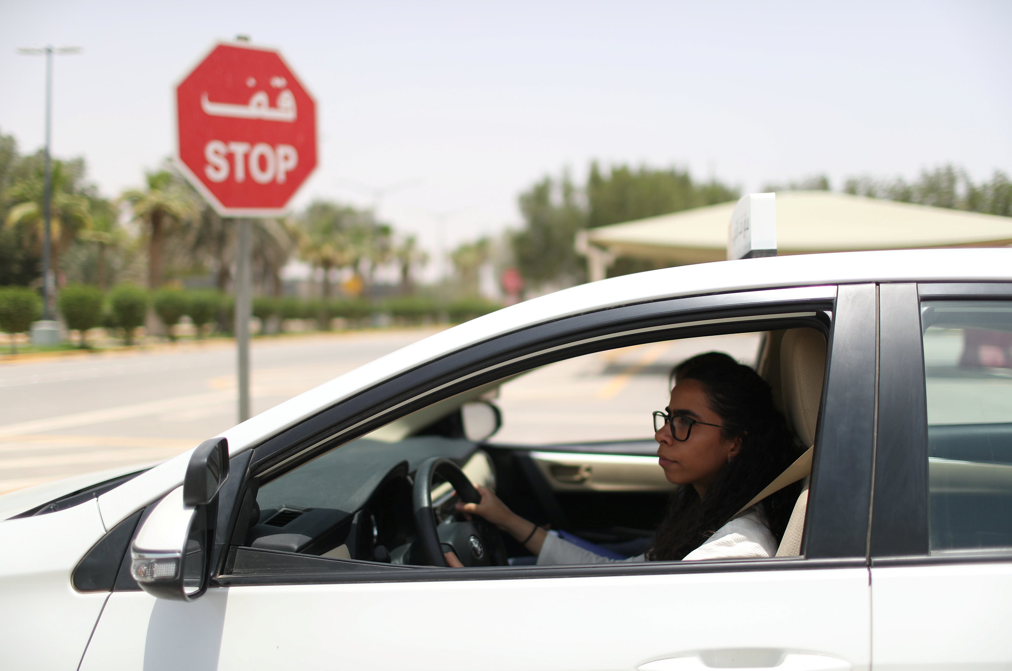 A woman taking a driving lesson in Saudi Arabia, June 2018