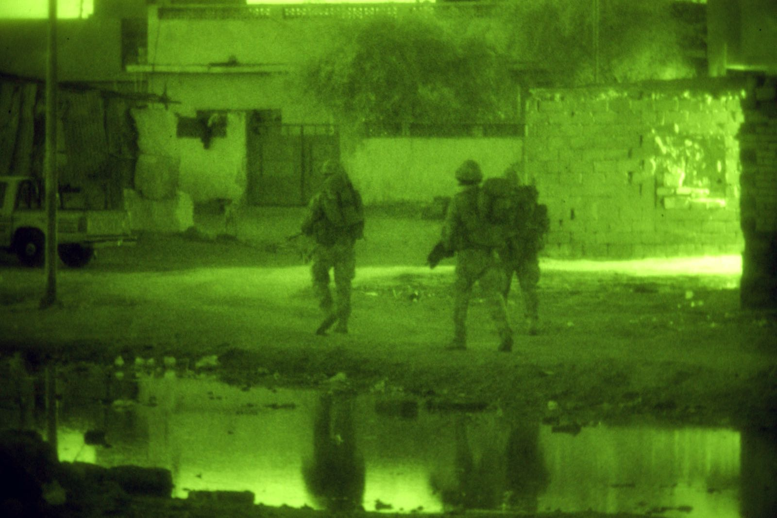 British soldiers patrolling near Sharkarta, Iraq in 2005 (UK Ministry of Defence)