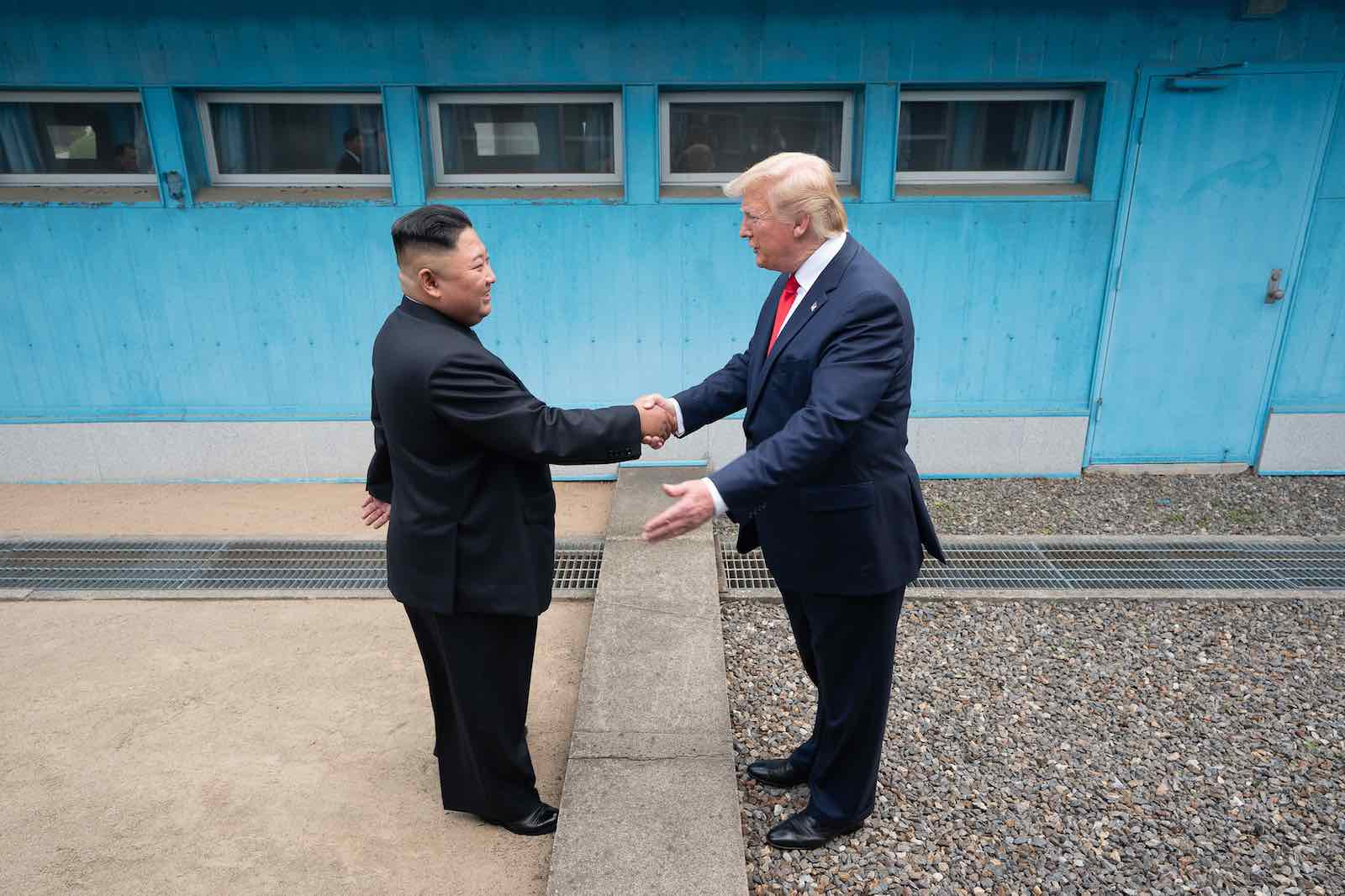 North Korean leader Kim Jong-un shakes hands with US President Donald Trump at the Demilitarized Zone between North and South Korea, 30 June 2019 (Photo: Shealah Craighead/The White House/Flickr)