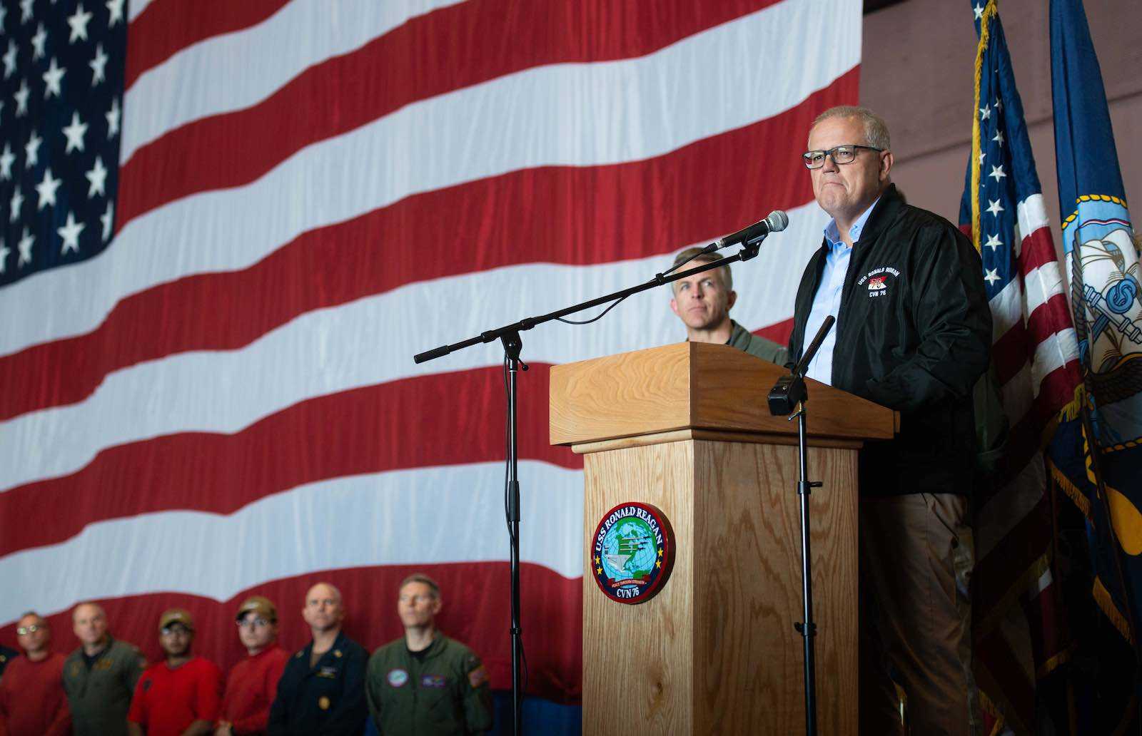Prime Minister Scott Morrison addresses sailors aboard the aircraft carrier USS Ronald Reagan in July (Photo: Official US Navy Page/Flickr)