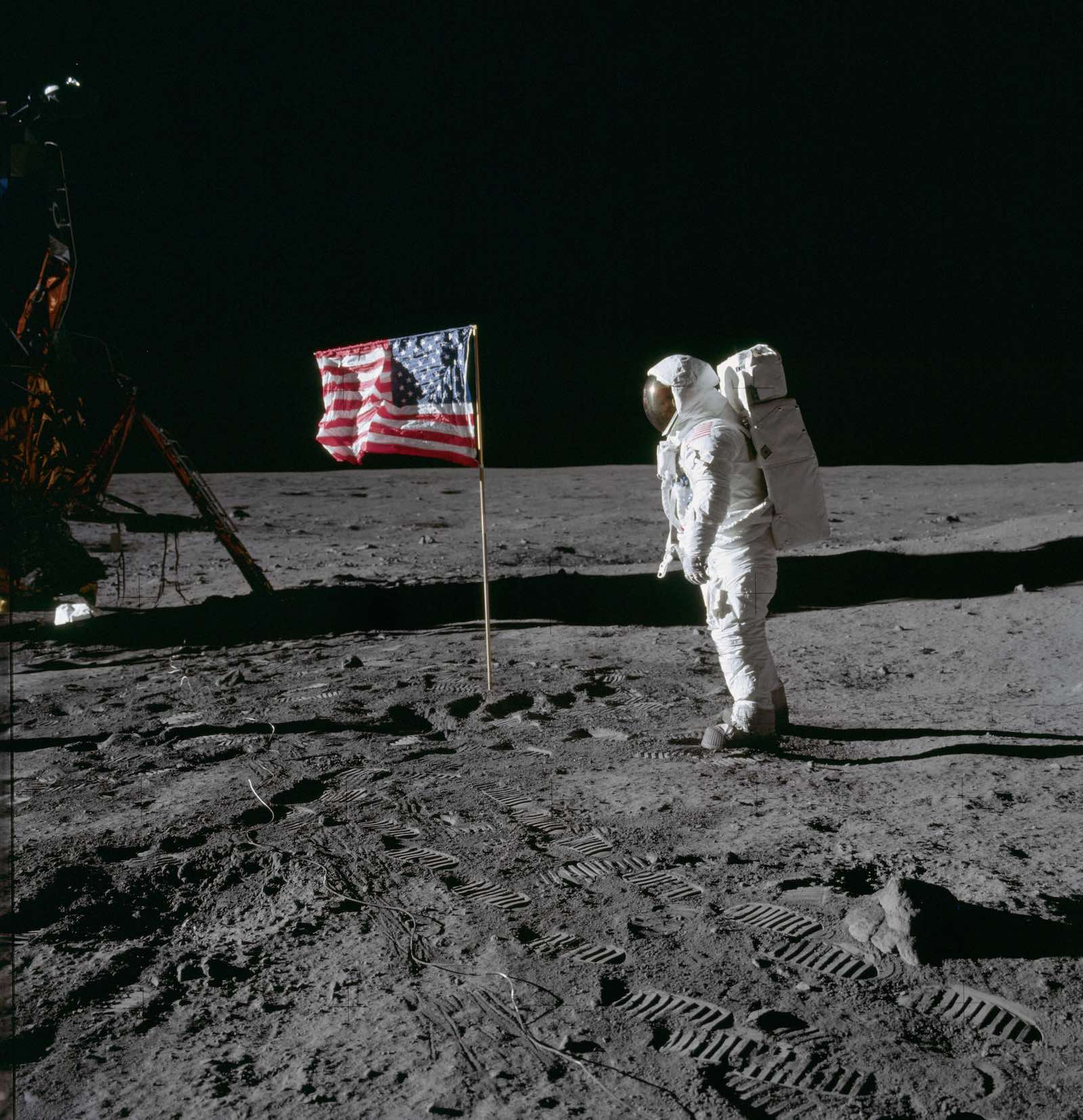 """Astronaut Edwin """"Buzz"""" Aldrin poses for photograph beside US flag on the surface of the Moon in 1969 (Photo: NASA Johnson/Flickr)"""