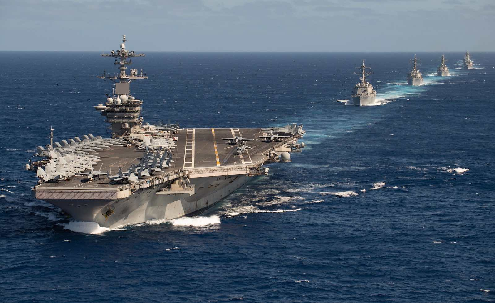 The US Theodore Roosevelt Carrier Strike Group in formation on transit last month to an Indo-Pacific deployment (Photo: US Navy/Flickr)
