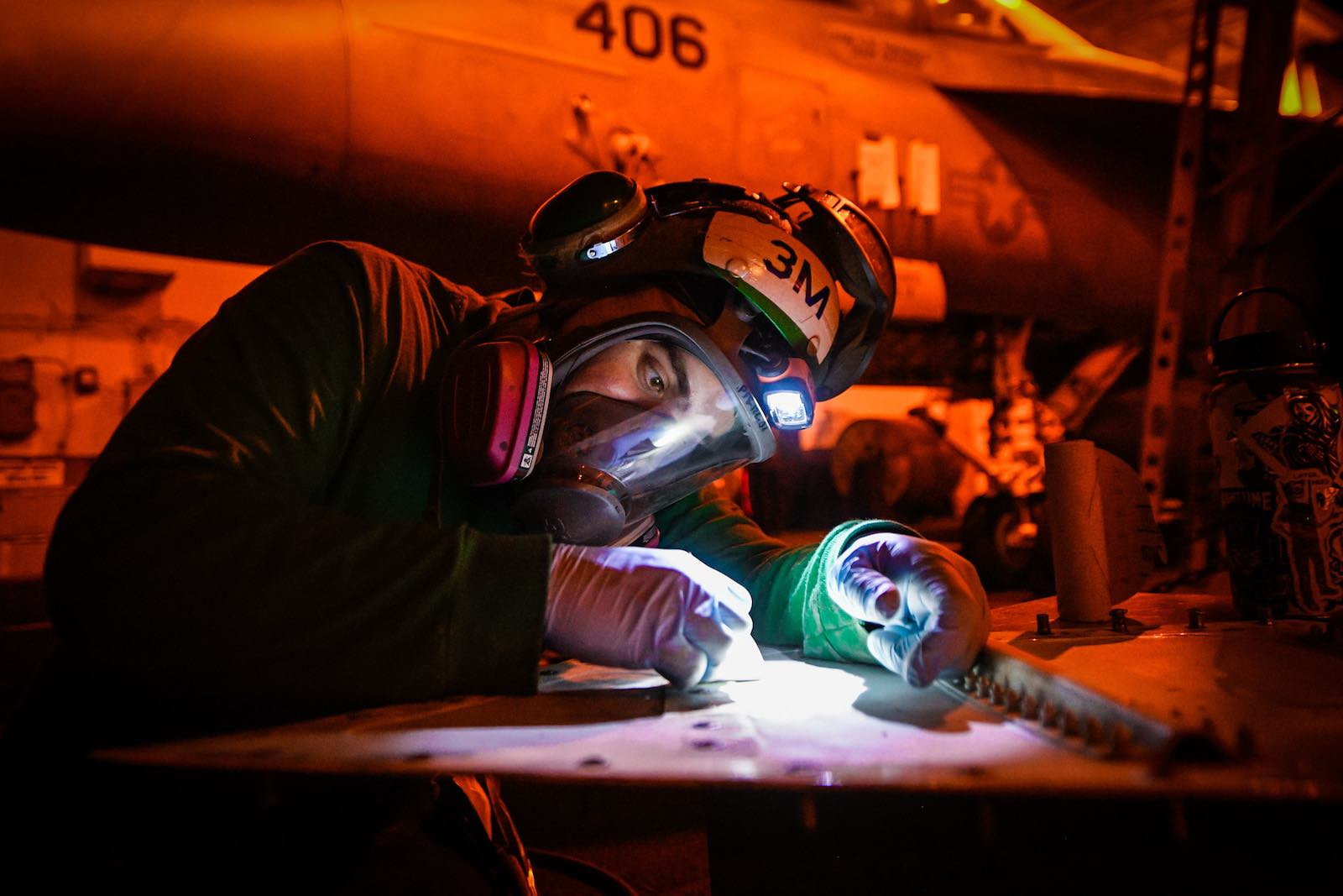Maintenance work aboard the aircraft carrier USS Theodore Roosevelt in March, the ship now at the centre of a Covid-19 outbreak (US Pacific Fleet/Flickr)