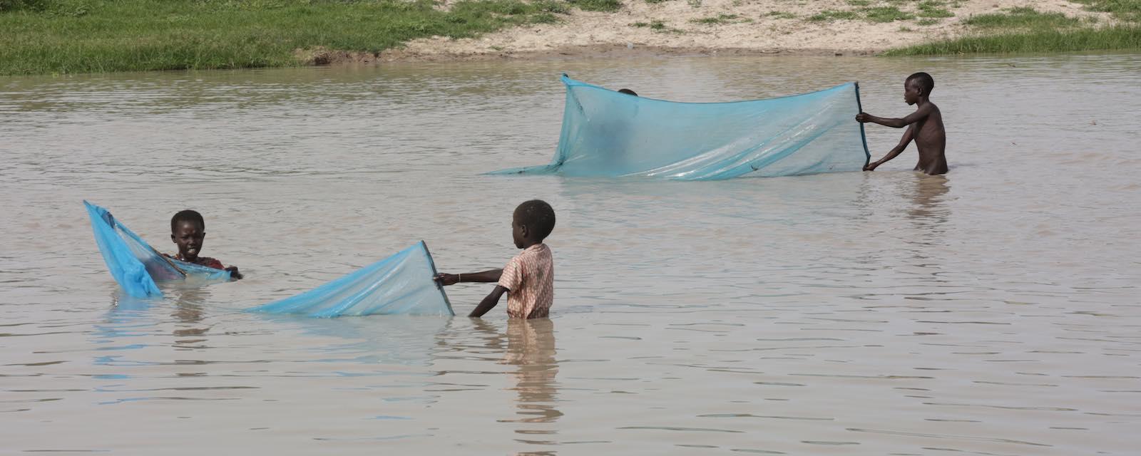 Children fish in the river in Pibor, South Sudan (Photo: Nektarios Markogiannis/UN Photo)