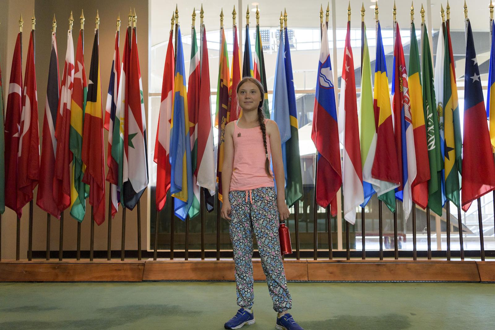 Greta Thunberg, climate activist from Sweden, poses outside of the General Assembly Hall at UN headquarters in New York (Photo: Manuel Elias/United Nations)