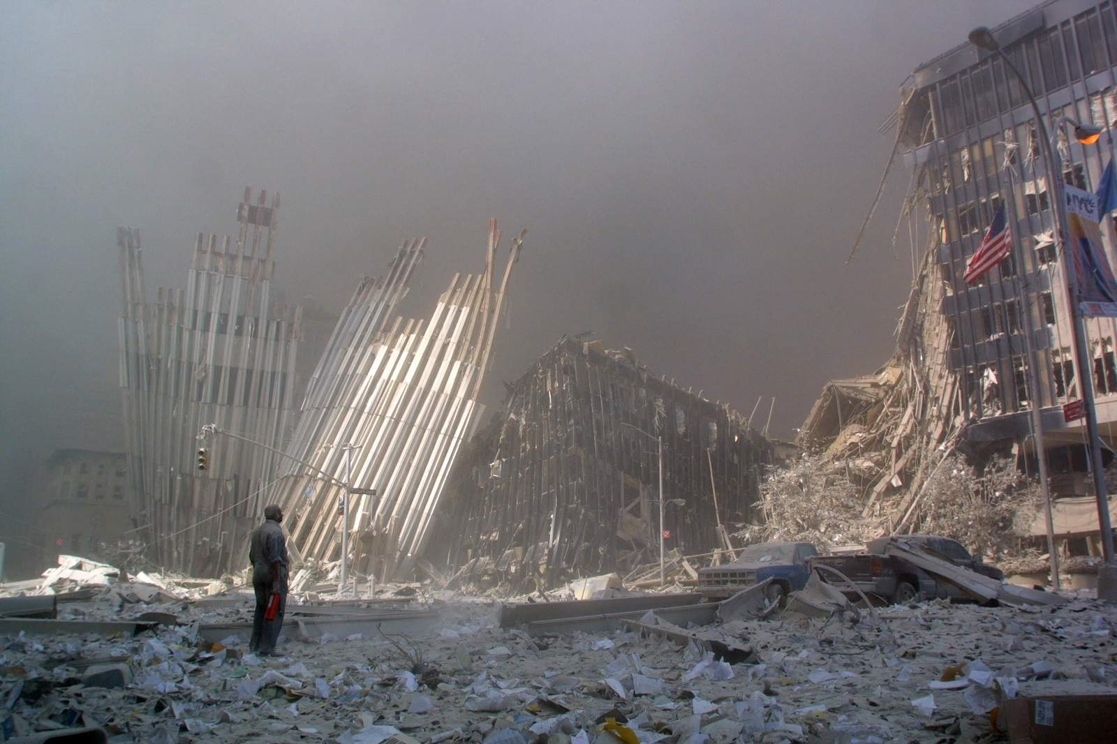 A man calls out asking if anyone needs help after the collapse of the first World Trade Centre tower, New York City, 11 September 2001 (Doug Kanter/AFP via Getty Images)