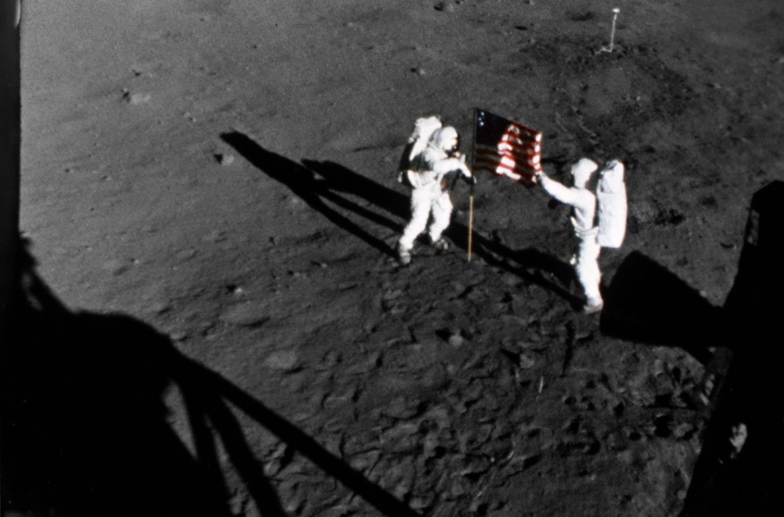 Neil Armstrong (left) and Buzz Aldrin unfurl the US flag on the surface of the Moon (Photo: NASA Johnson/Flickr)