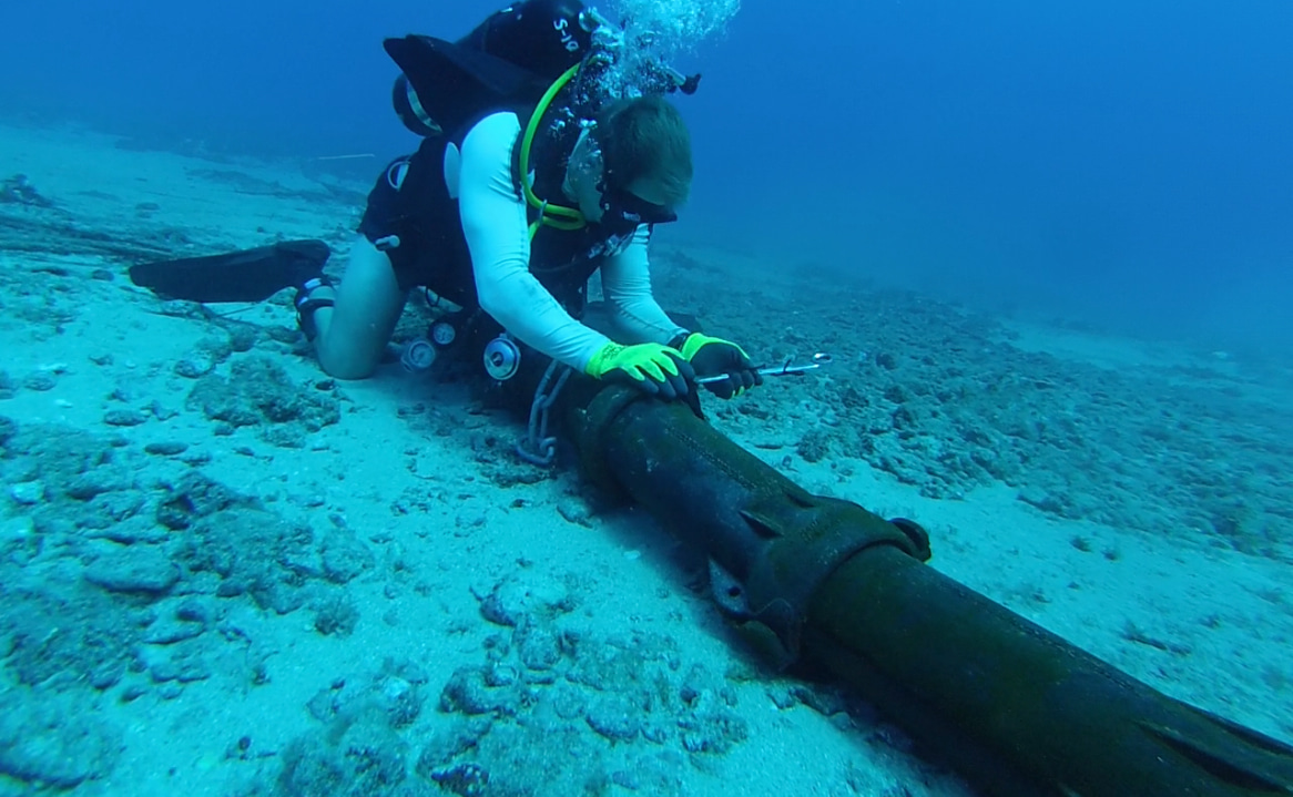 A US Navy diver installs steel armour on an undersea cable (Photo: US Pacific Fleet/Flickr)