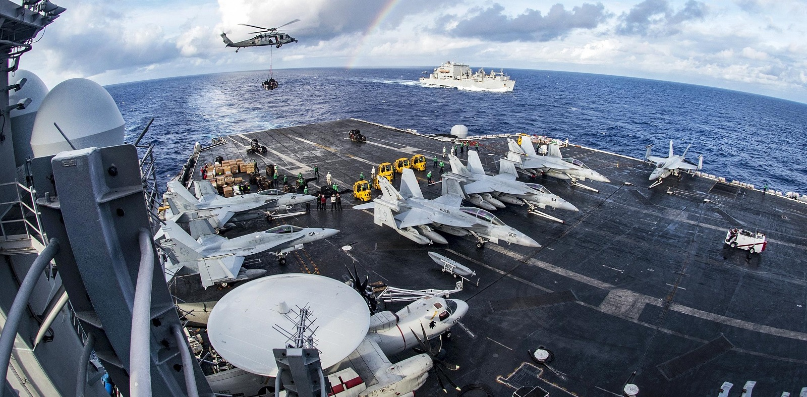 The USS Carl Vinson in a vertical replenishment with Helicopter Sea Combat Squadron 4 and the USNS Charles Drew (Photo: US Dept of Defense)