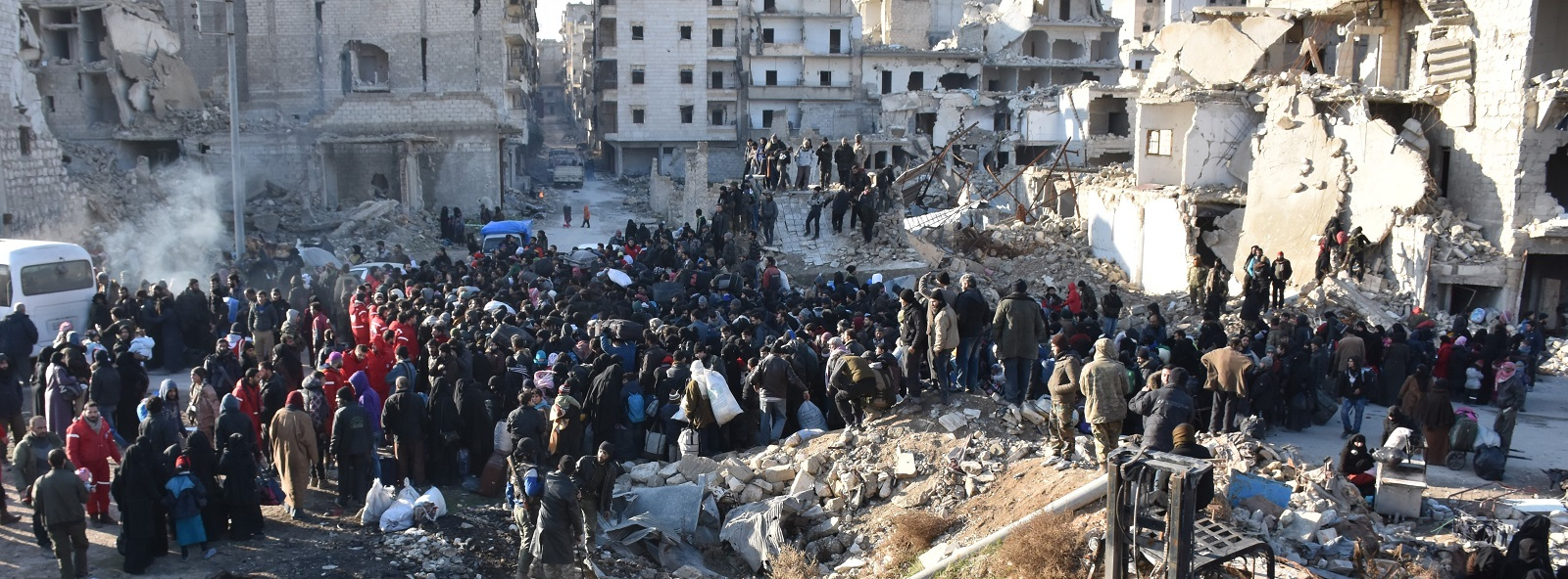 Civilians wait to be evacuated from East Aleppo (Photo: Mustafa Sultan/Getty Images)