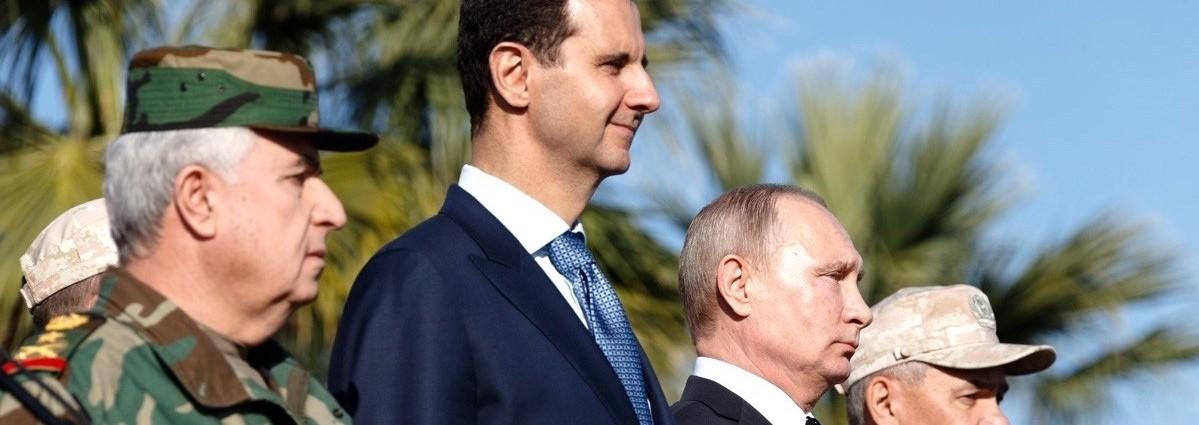 Russian President Vladimir Putin and Syrian President Bashar al-Assad visit Hmeymim base, Syria, in 2017 (Photo: Kremlin Press Office/Getty)