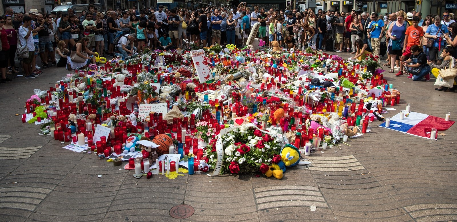 People gather around tributes on Las Ramblas near the scene of Thursday's terrorist attack in Barcelona. (Photo:Carl Court/Getty Images)