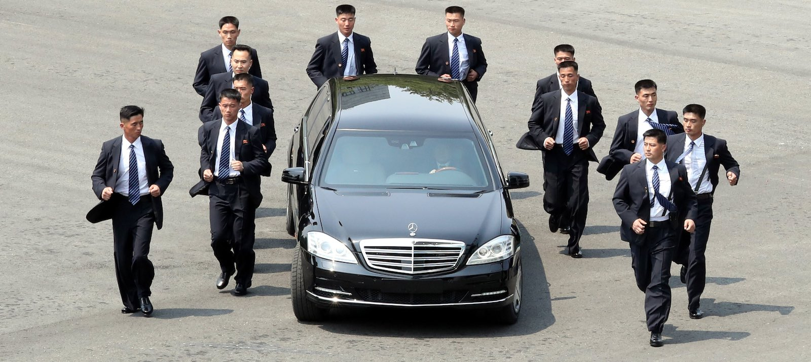 North Korean Leader Kim Jong-un escorted by his jogging bodyguards (Photo: Getty Images)
