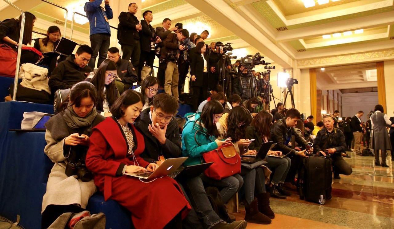Journalists reporting from the 12th National People's Congress in Beijing on 5 March. (Photo: VCG/Getty Images)