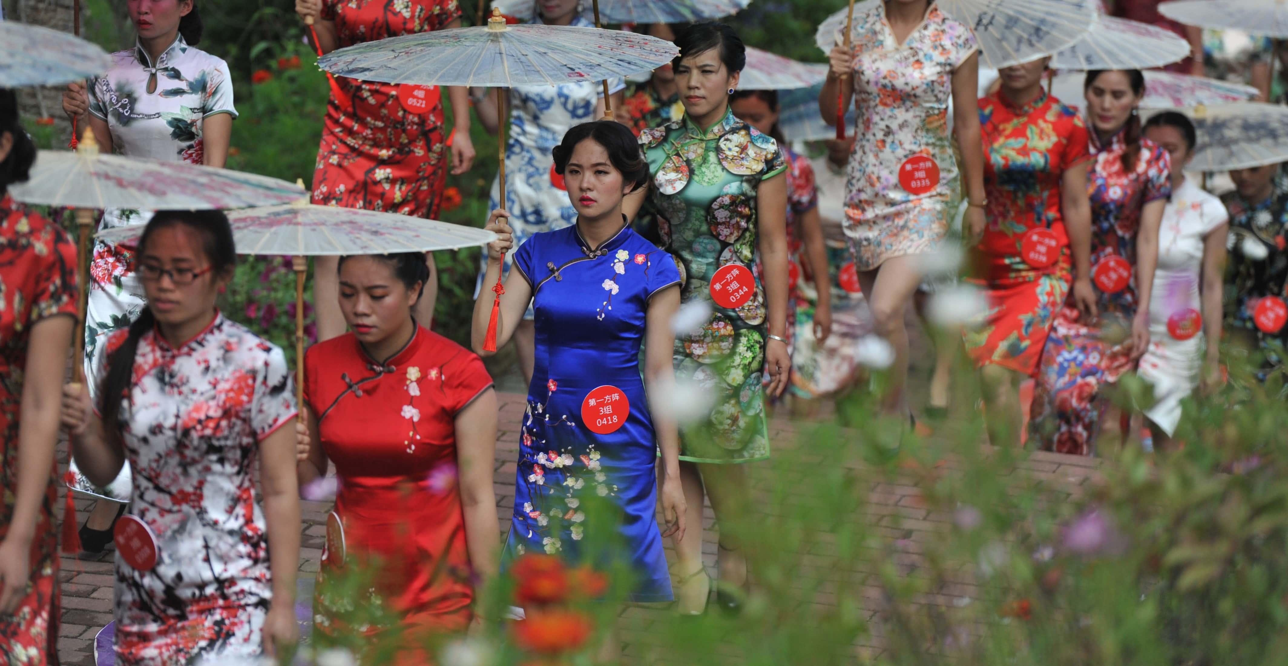 Women wearing cheongsams in Liupanshui, China (Photo: VCG via Getty Images)