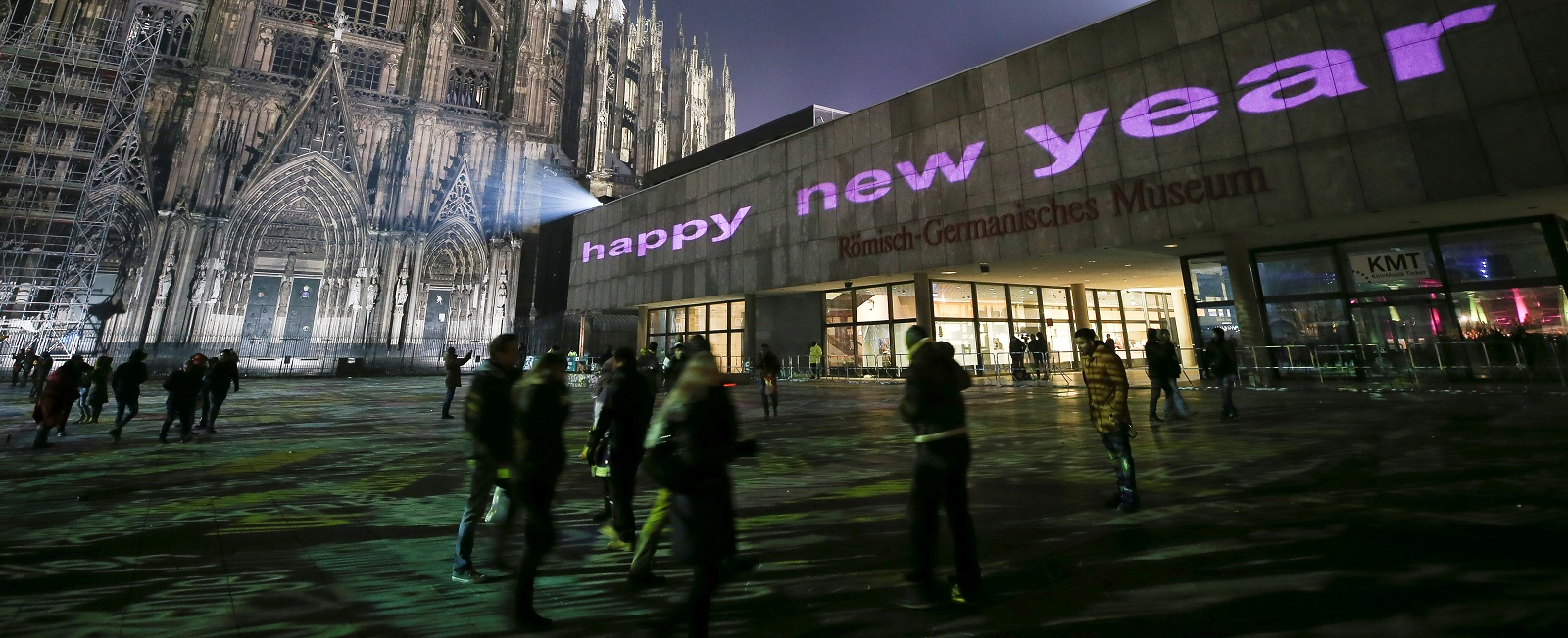 Visitors celebrate New Year's Eve in front of Cologne Cathedral, Germany (Photo by Maja Hitij/Getty Images)
