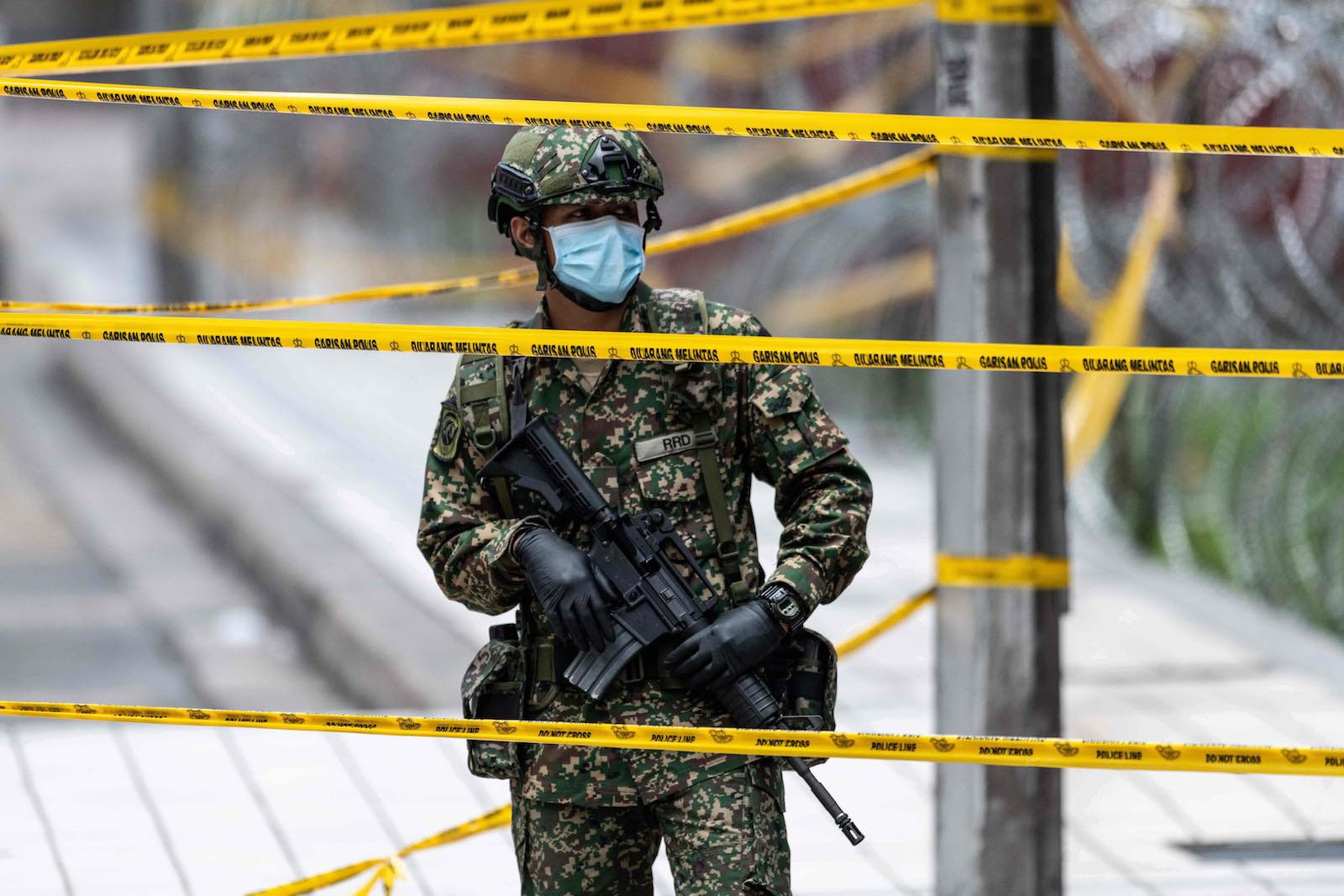 A soldier in Kuala Lumpur guarding a cordoned-off area (Mohd Rasfan/AFP/Getty Images)