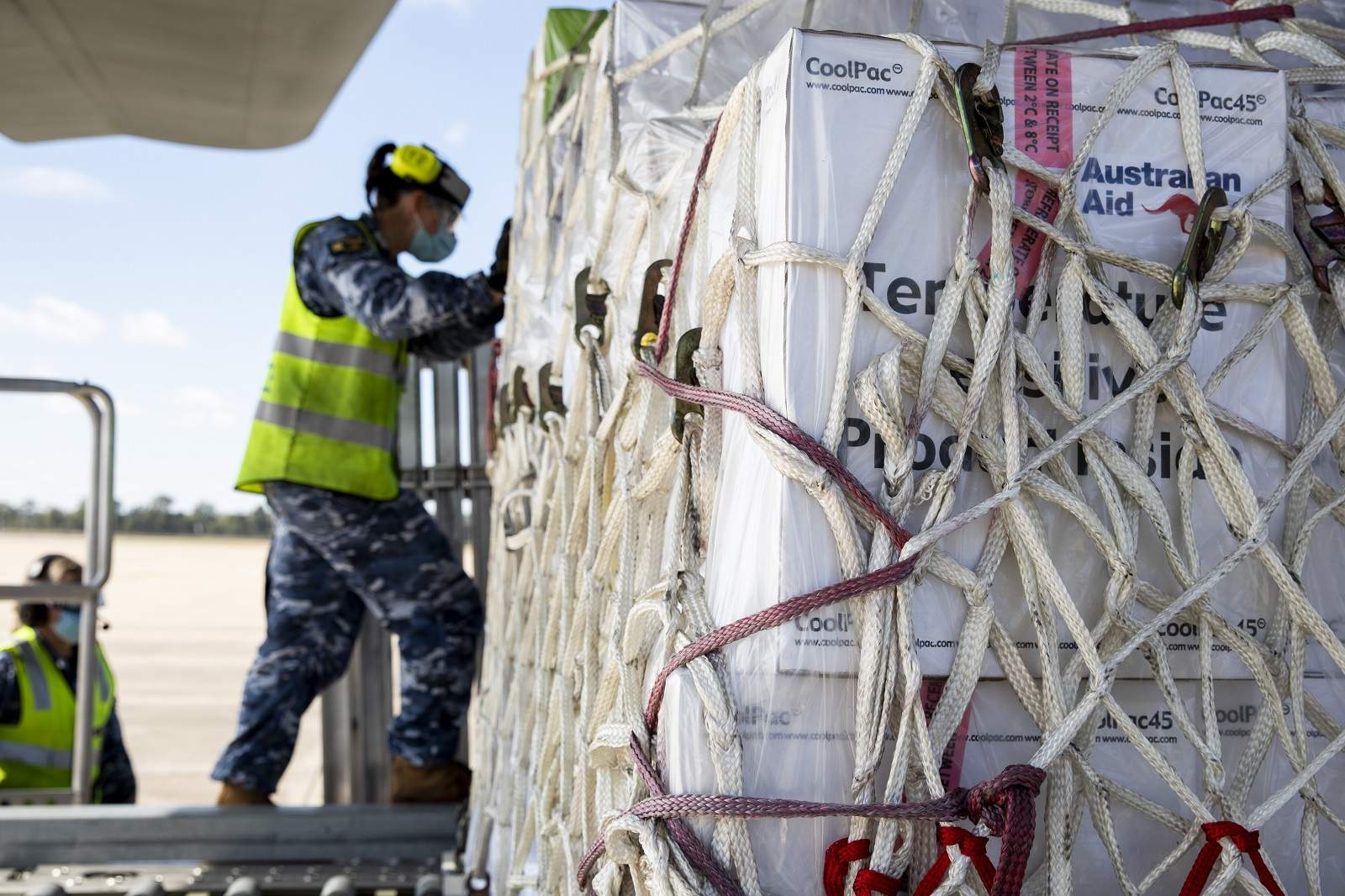 Air Movements Operators from No 23 Squadron load pallets of AstraZeneca vaccines and Covid-19 medical supplies bound for Fiji onto a C-130J Hercules at RAAF Base Amberley (defence.gov.au)