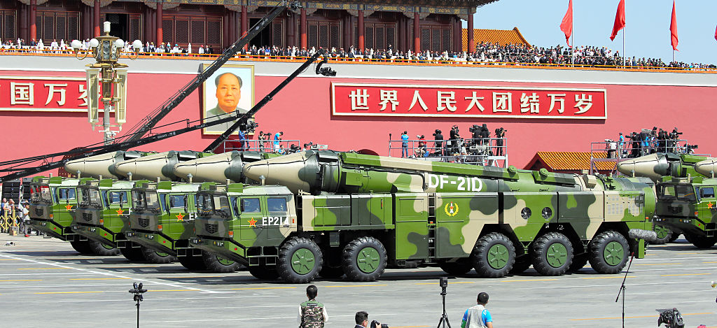 DF-21D anti-ship ballistic missiles drive through Tiananmen Square during a military parade on September 3, 2015. (Getty/Asahi Shimbun)