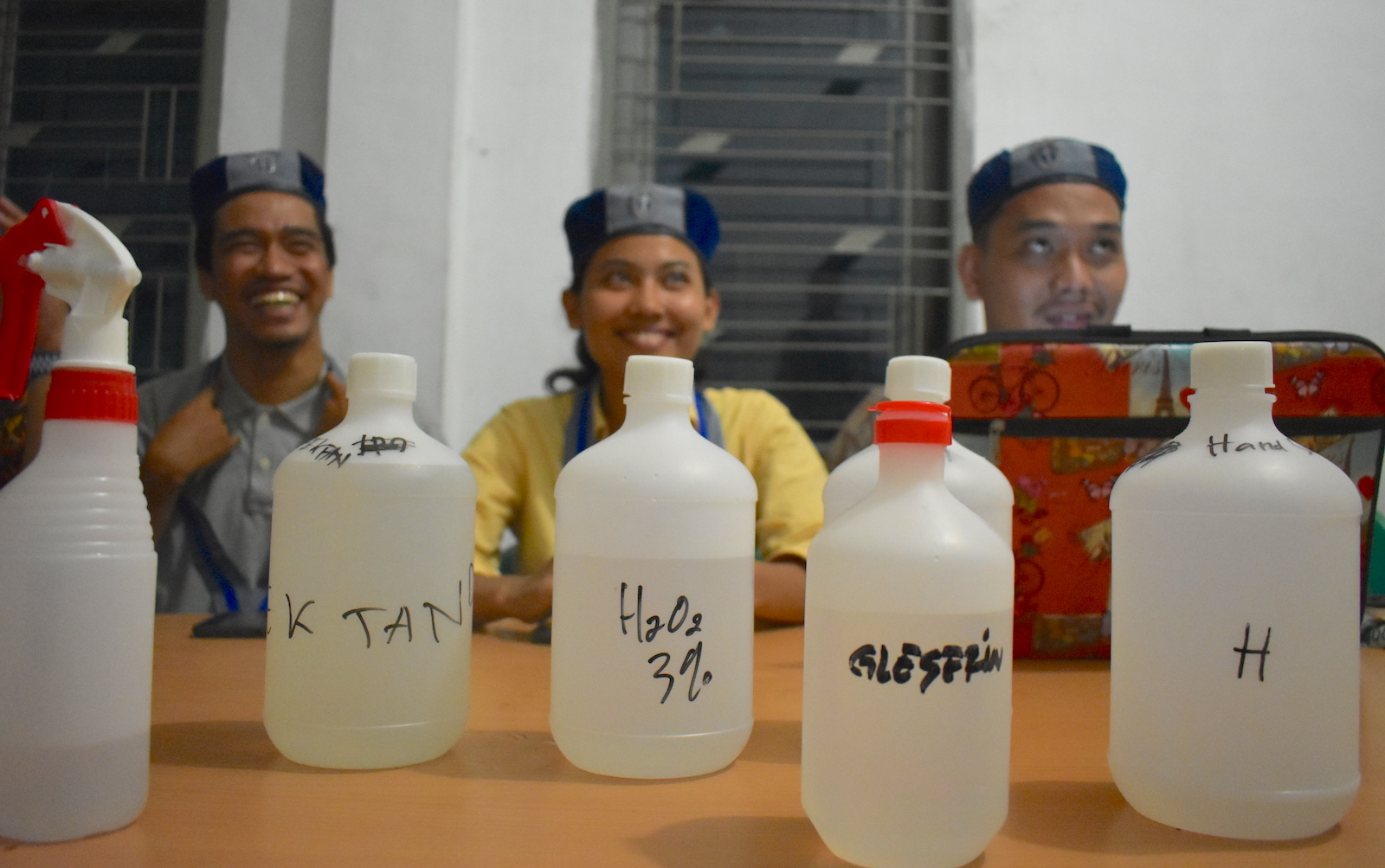 students from GMKI, or the Indonesian Students' Christian Movement, making hand sanitiser (Supplied photos)