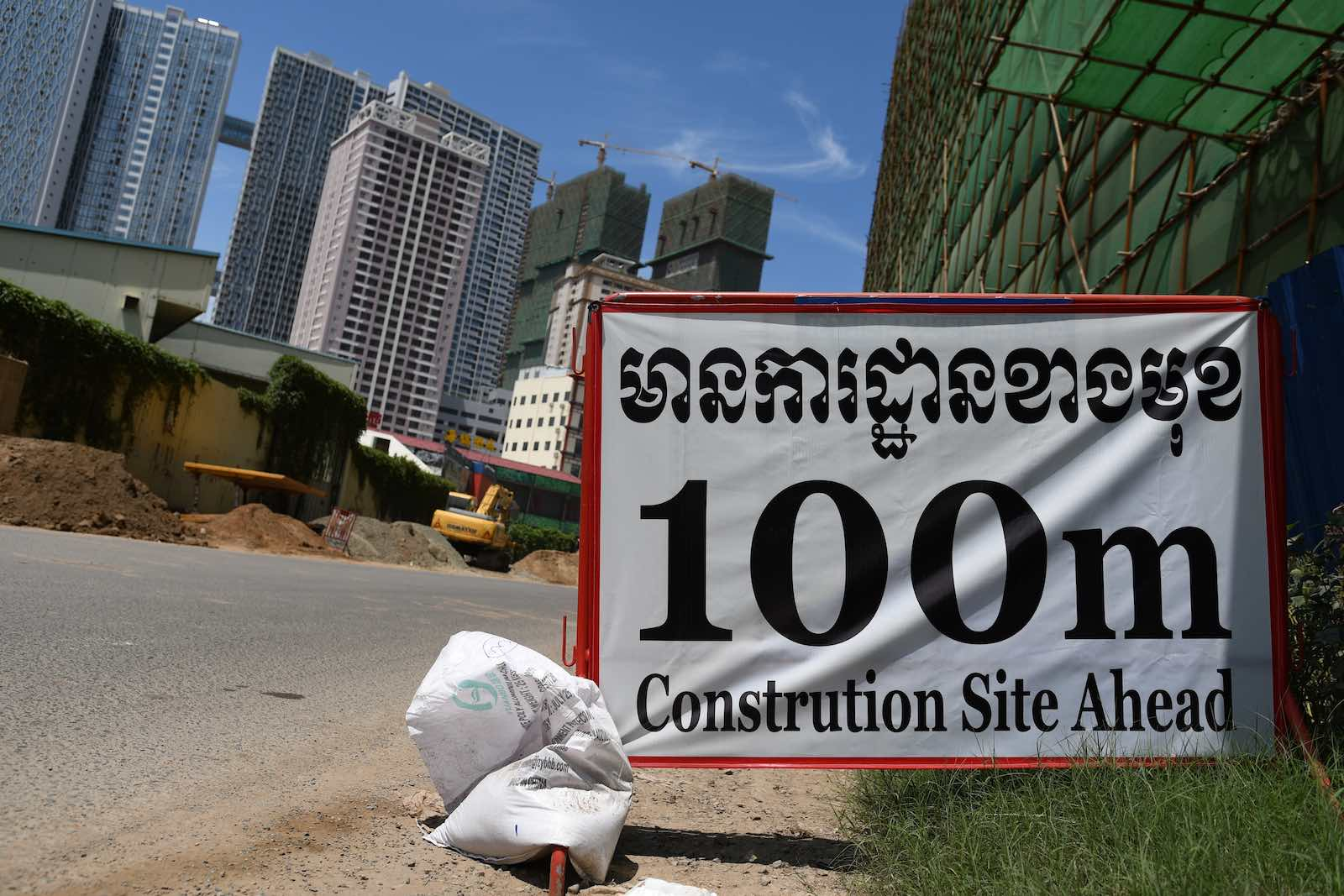 Occasional road-signs to warn passers-by does not do justice to the intensity of construction seen in the Cambodian capital (Photos by Simon Roughneen)