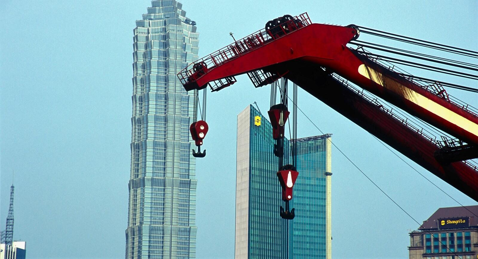 Jinmao Tower with crane, Shanghai, China (Photo: Liqun Liu via Getty)