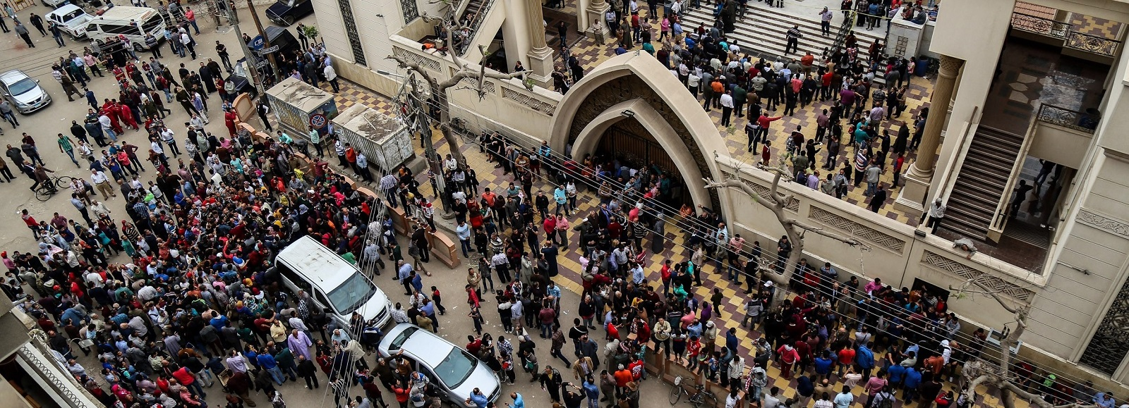 People gather in front of the Saint George church in Tanta after a bomb struck inside on 9 April (Photo: Ibrahim Ramadan/Getty Images)