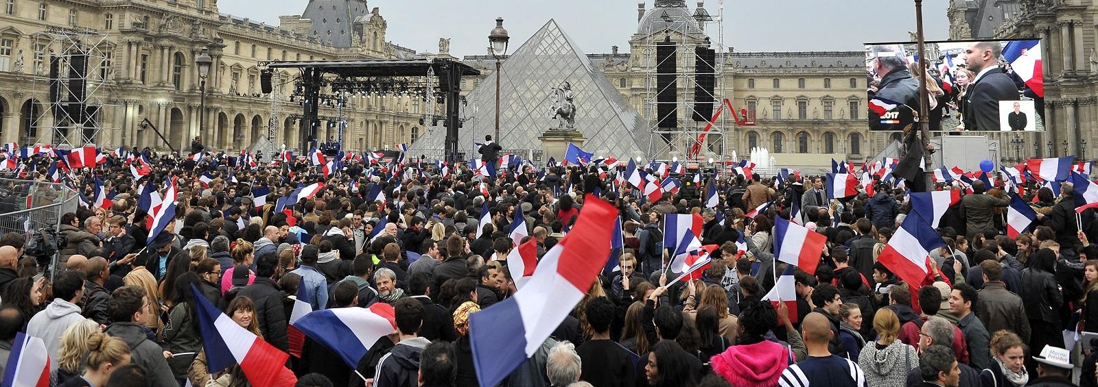 Emmanuel Macron supporters outside the Louvre, Paris on Sunday evening (Photo: Aurelien Meunier/Getty)