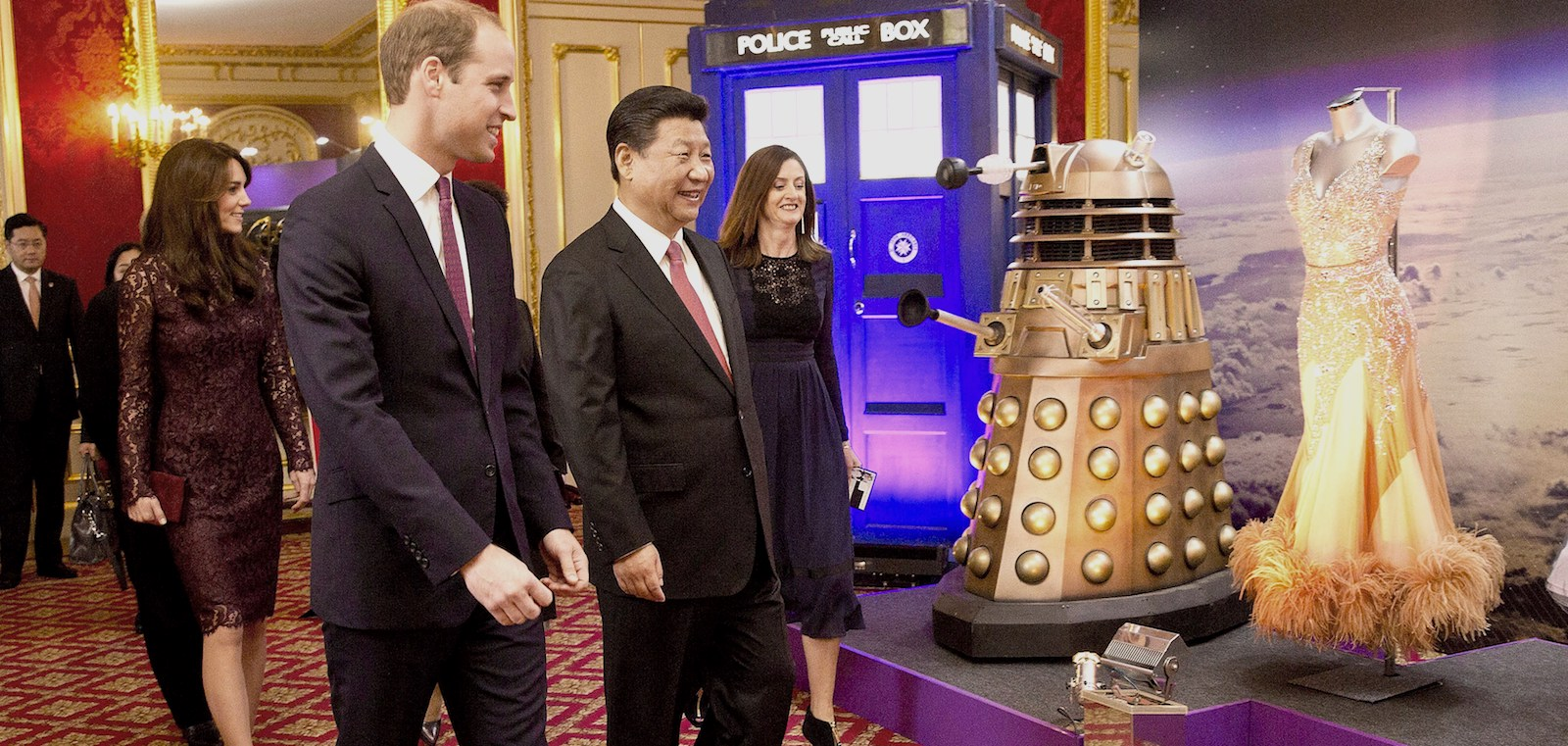 Catherine, Duchess of Cambridge, Prince William, and Chinese President Xi Jinping, walk past a Doctor Who display (Photo: Heathcliff O'Malley/Getty)