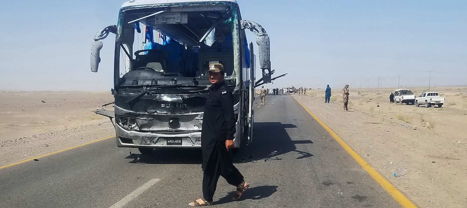 The aftermath of a 11 August suicide attack on a bus carrying Chinese engineers in Dalbandin region, Balochistan province in Pakistan (Photo: Ali Raza/Getty)