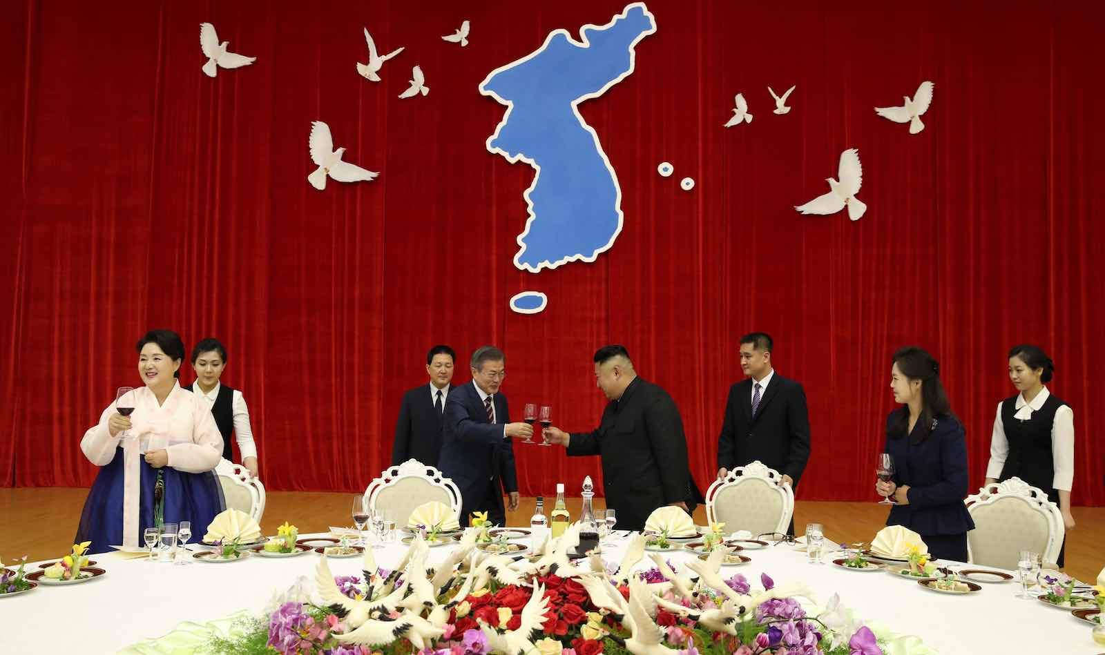 South Korea's President Moon Jae-in toasts with North Korea's Kim Jong-un on 18 September in Pyongyang, North Korea (Photo: Pyongyang Press Corps/Getty)