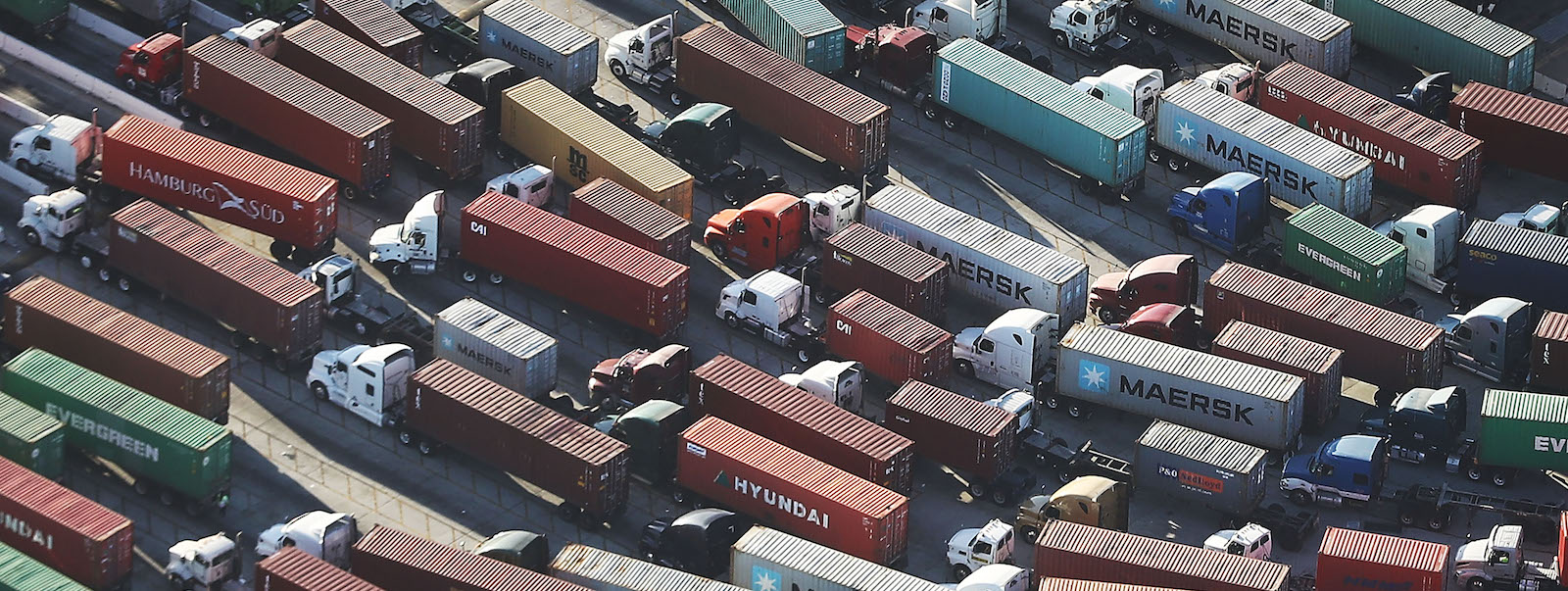 Trucks haul shipping containers at the Port of Los Angeles, California (Photo: Mario Tama via Getty)