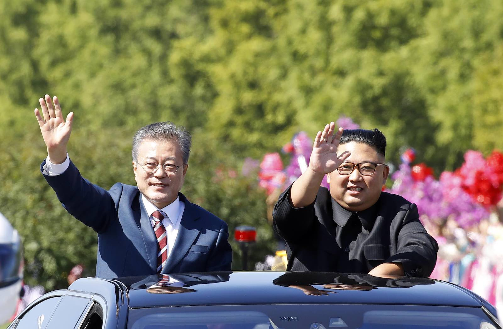 South Korean President Moon Jae-in and North Korean leader Kim Jong-un in a car parade, September 2018 in Pyongyang (Photo by Pyeongyang Press Corps/Getty Images)