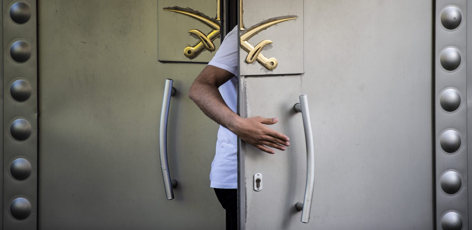 A Saudi official enters the door of the Saudi consulate in Istanbul, the last known location of journalist Jamal Khashoggi (Photo: Yasin Akgul via Getty)