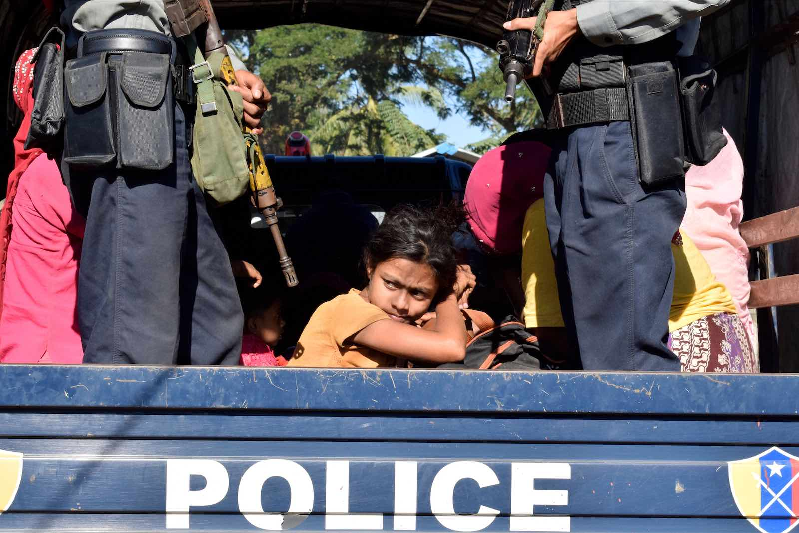 Myanmar police escort Rohingya back to their camp in Sittwe, Rakhine state, after being detained at sea, November 2018 (Photo: AFP/Getty Images)