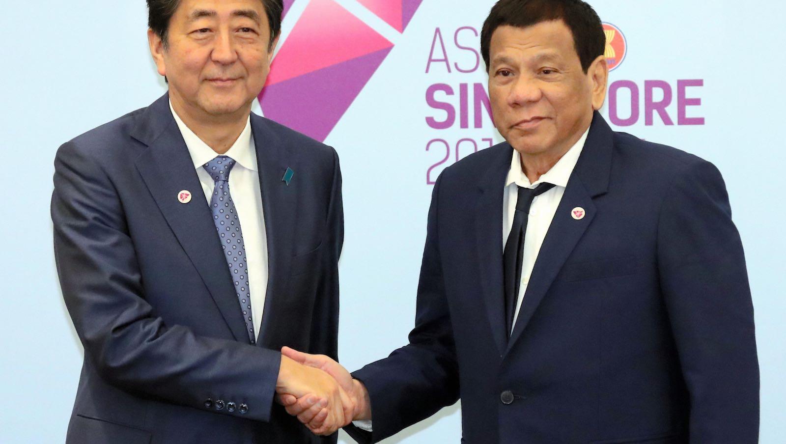 """Closer than brothers"": Japan's Shinzo Abe and Philippine President Rodrigo Duterte in November 2018 (Photo: Asahi Shimbun via Getty)"